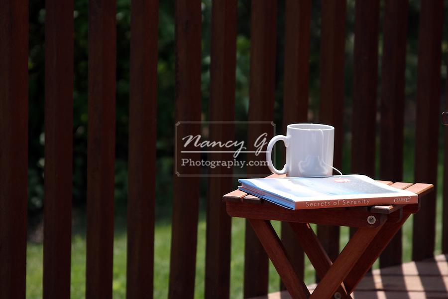 A wooden table on a deck in the morning with tea and the secrets of serenity