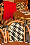 Outdoor cafe table and chairs with blankets provided for the cold winter days in Paris, France