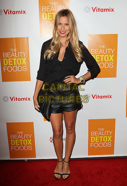 "Renee Bargh.Celebrity Nutritonist Kimberly Snyder Hosts Book Launch Party For ""The Beauty Detox Foods"" At Smashbox, Hollywood, California, USA..March 26th, 2013.full length black top leather shorts clutch bag hand on hip.CAP/ADM/KB.©Kevan Brooks/AdMedia/Capital Pictures."