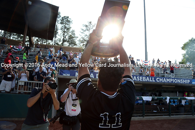 04 June 2016: Nova Southeastern's Devin Raftery shows the trophy to the fans. The Nova Southeastern University Sharks played the Millersville University Marauders in Game 14 of the 2016 NCAA Division II College World Series  at Coleman Field at the USA Baseball National Training Complex in Cary, North Carolina. Nova Southeastern won the game 8-6 and clinched the NCAA Division II Baseball Championship.