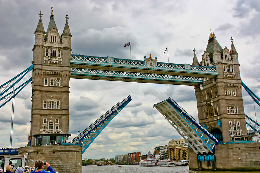 A rare view of Tower Bridge in London with the lift bridge in the raised position