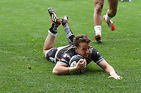 Sunday 19 October 2014<br /> Pictured: Replacemt scrum-half Martin Roberts goes over for a try.<br /> Re: Ospreys v Treviso, Heineken Champions Cup at the Liberty Stadium, Swansea