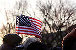 Spectators wave American flags during the inauguration of Barack Obama as the 44th president of the United States of America, Tuesday, Jan. 20, 2009, in Washington, D.C. (Heather Halstead/pressphotointl.com)