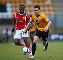 James Jennings of Cambridge United races away from Mathias Pogba of Wrexham during the Blue Square Bet Premier match between Cambridge United and Wrexham at the Abbey Stadium, Cambridge on 22nd January, 2011 .© Kevin Coleman 2011