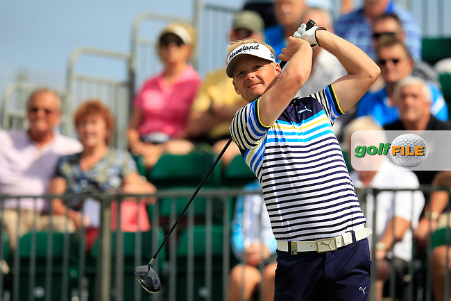 Soren Kjeldsen (DEN) tees off the 1st tee to start his match during Saturday's Round 3 of the 2013 Portugal Masters held at the Oceanico Victoria Golf Club. 12th October 2013.<br /> Picture: Eoin Clarke www.golffile.ie