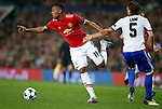 Anthony Martial of Manchester United (L) skips past Michael Lang of Basel during the Champions League Group A match at the Old Trafford Stadium, Manchester. Picture date: September 12th 2017. Picture credit should read: Andrew Yates/Sportimage