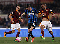 Calcio, Serie A: Roma vs Inter. Roma, stadio Olimpico, 19 marzo 2016.<br /> FC Inter&rsquo;s Marcelo Brozovic, center, is challenged by Roma&rsquo;s Seydou Keita, right, and Diego Perotti, during the Italian Serie A football match between Roma and FC Inter at Rome's Olympic stadium, 19 March 2016. The game ended 1-1.<br /> UPDATE IMAGES PRESS/Isabella Bonotto