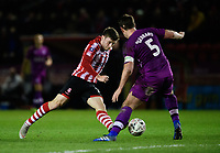 Lincoln City's Shay McCartan vies for possession with Carlisle United's Anthony Gerrard<br /> <br /> Photographer Chris Vaughan/CameraSport<br /> <br /> The Emirates FA Cup Second Round - Lincoln City v Carlisle United - Saturday 1st December 2018 - Sincil Bank - Lincoln<br />  <br /> World Copyright © 2018 CameraSport. All rights reserved. 43 Linden Ave. Countesthorpe. Leicester. England. LE8 5PG - Tel: +44 (0) 116 277 4147 - admin@camerasport.com - www.camerasport.com
