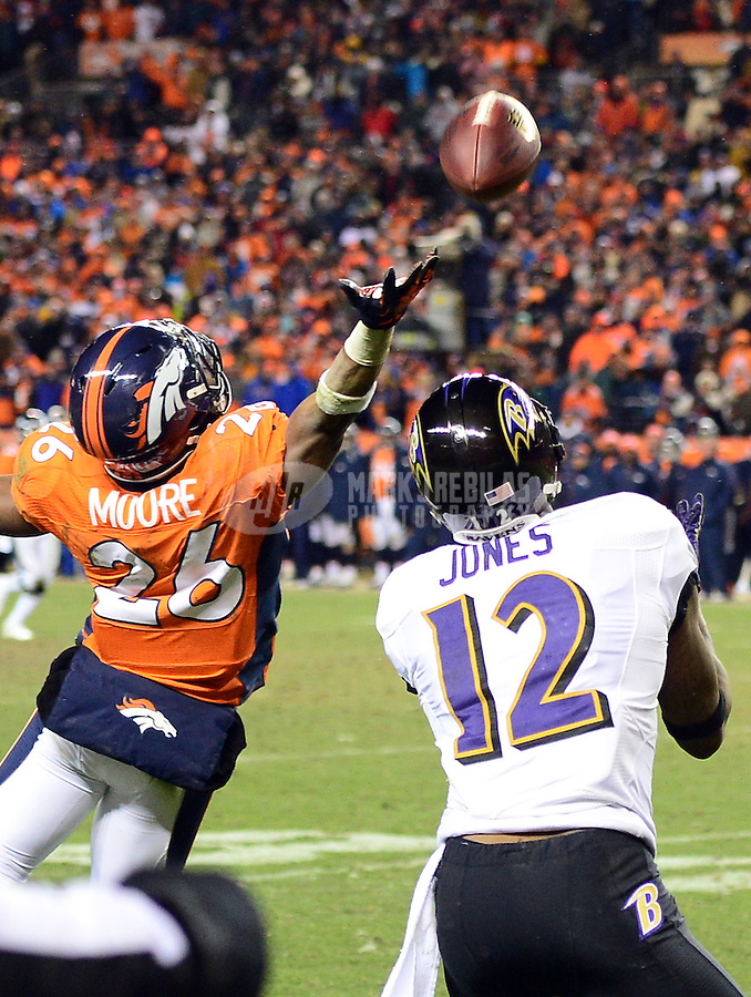 Jan 12, 2013; Denver, CO, USA; Baltimore Ravens wide receiver Jacoby Jones (12) catches a touchdown in the fourth quarter under pressure from Denver Broncos safety Rahim Moore (26) in the fourth quarter during the AFC divisional round playoff game at Sports Authority Field.  The Ravens defeated the Broncos 38-35 in double overtime. Mandatory Credit: Mark J. Rebilas-