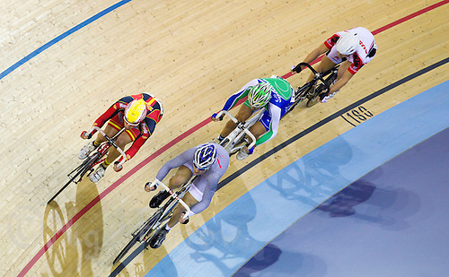 17 FEB 2012 - LONDON, GBR - Competitors race round the track during the Men's Points Race final at the UCI Track Cycling World Cup and London Prepares test event for the 2012 Olympic Games in the Olympic Park Velodrome in Stratford, London, Great Britain .(PHOTO (C) 2012 NIGEL FARROW)