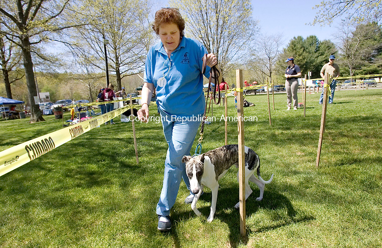 WOODBURY CT. 05 May 2013-050513S04-Cindy Schroder of Naugatuck takes her dog Pipper through an obstacle course the Woodbury's Dog Day event at Hollow Park in Woodbury Sunday. .Steven Valenti Republican-American