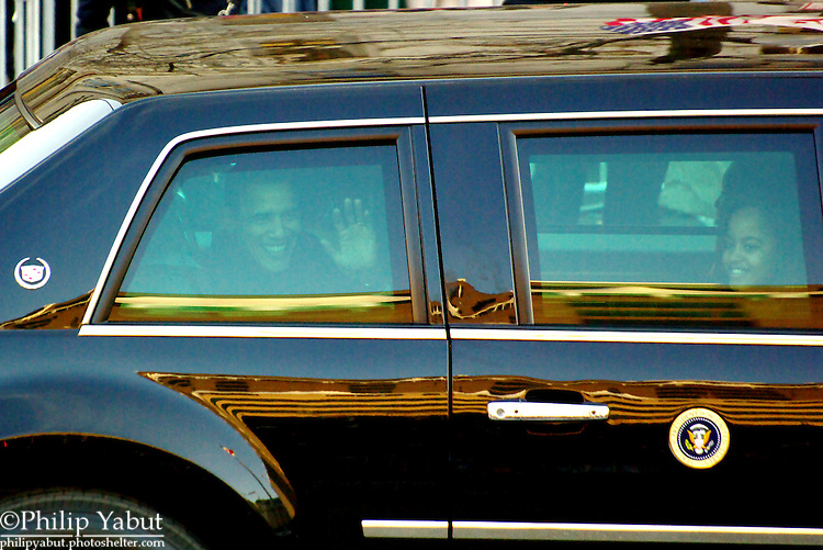 President Barack Obama and his family ride down Pennsylvania Avenue on Inauguration Day.