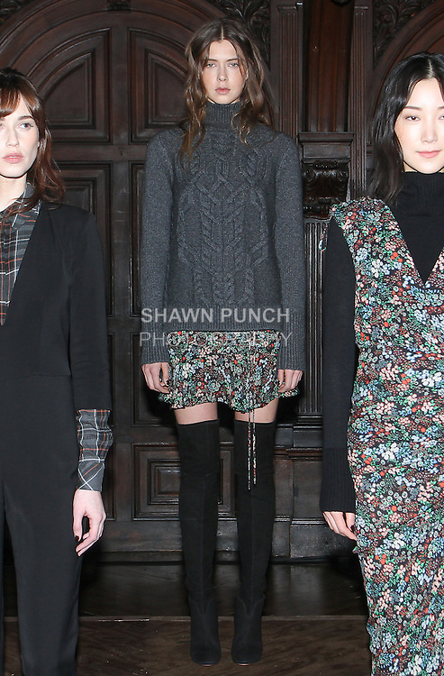"""Model Aleksandra poses in a heather grey chunky cable knit turtleneck tunic, and fall garden print georgette ruched drawstring flounce mini, from the Veronica Beard Fall 2016 """"Gypsy Caravan"""" collection presentation, at the Highline Hotel on February 15 2016, during New York Fashion Week Fall 2016."""
