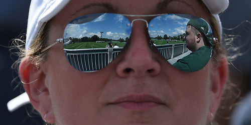 Laura Wisse of Long Valley, NJ looks out onto the playing field during a day of New York Jets Training Camp at the Atlantic Health Jets Training Center in Florham Park, NJ on Saturday, Aug. 18, 2018. Reflected in her sunglasses is her son Tyler Wisse.