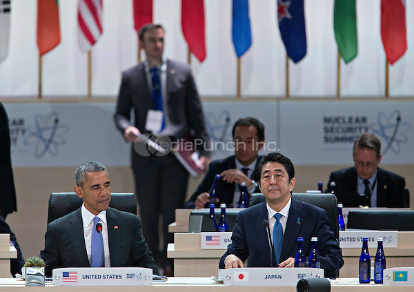 United States President Barack Obama, left, and Shinzo Abe, Japan's prime minister, wait to begin an opening plenary entitled &quot;National Actions to Enhance Nuclear Security&quot; at the Nuclear Security Summit in Washington, D.C., U.S., on Friday, April 1, 2016. After a spate of terrorist attacks from Europe to Africa, Obama is rallying international support during the summit for an effort to keep Islamic State and similar groups from obtaining nuclear material and other weapons of mass destruction. <br /> Credit: Andrew Harrer / Pool via CNP/MediaPunch