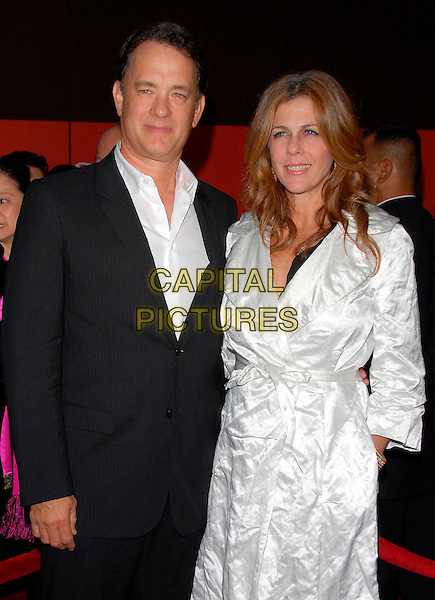 TOM HANKS & RITA WILSON.Attend the Sony Global Conference Party held on Rodeo Drive in Beverly Hills, California, USA,.September 29th 2006..Half length married husband wife white belted coat mac hand in pocket suit.Ref: DVS.www.capitalpictures.com.sales@capitalpictures.com.©Debbie VanStory/Capital Pictures