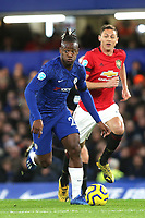 Michy Batshuayi of Chelsea in action as Manchester United's Nemanja Matic looks on during Chelsea vs Manchester United, Premier League Football at Stamford Bridge on 17th February 2020