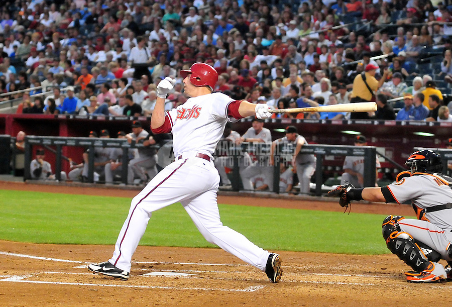 Apr. 21, 2008; Phoenix, AZ, USA; Arizona Diamondbacks third baseman Mark Reynolds hits a solo home run in the second inning against the San Francisco Giants at Chase Field. Mandatory Credit: Mark J. Rebilas-