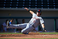 Scottsdale Scorpions outfielder Mike Gerber (9) slides into home during an Arizona Fall League game against the Mesa Solar Sox on October 19, 2015 at Sloan Park in Mesa, Arizona.  Scottsdale defeated Mesa 10-6.  (Mike Janes/Four Seam Images)