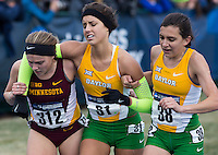 Minnesota's Kate Bucknam (312) and Baylor's Madison Zimmerman help Zimmerman's teammate, Anna Dunlap Marie (31), across the final few meters of the women's race during the NCAA Cross Country Championships in Terre Haute, Ind. on Saturday, Nov. 22, 2014. (James Brosher, Special to the Denver Post)