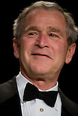 Washington, D.C. - April 21, 2007 - United States President George W. Bush smiles as he arrives at the White House Correspondents Association Dinner April 21, 2007 in Washington, DC.  Comedian Rich Little hosted and provided entertainment for Bush, White House reporters, their guests and celebrities.  .Credit: Brendan Smialowski - Pool via CNP
