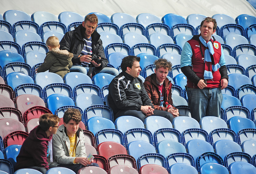 Burnley fans inside the ground before the game<br /> <br /> Photo by Chris Vaughan/CameraSport<br /> <br /> Football - The Football League Sky Bet Championship - Burnley v Ipswich Town - Saturday 26th April 2014 - Turf Moor - Burnley<br /> <br /> &copy; CameraSport - 43 Linden Ave. Countesthorpe. Leicester. England. LE8 5PG - Tel: +44 (0) 116 277 4147 - admin@camerasport.com - www.camerasport.com