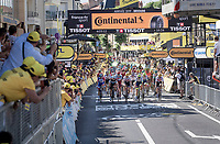peloton crossing the finish line 16+ minutes behind the race winner<br /> <br /> Stage 9: Saint-Étienne to Brioude (170km)<br /> 106th Tour de France 2019 (2.UWT)<br /> <br /> ©kramon
