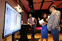 NWA Democrat-Gazette/DAVID GOTTSCHALK Gerald Mitchell (from left) listens to Tope Mitchell, both with Reflect Me, describe Tuesday, June 4, 2019, the business model for Reflekt Me to Ashish Bahrara, with i2i Labs, during the introduction of Anchor at Sunrise Stage in Fayetteville. Anchor, that will occupy the former Sears at the Northwest Arkansas Mall, is a an innovation lab that features office spaces, a conference center and an event venue.