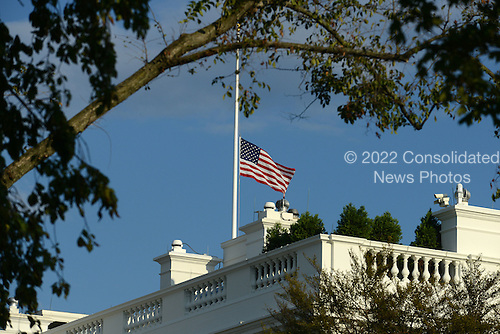 The United States flag that flies over the White House in Washington, D.C. is lowered to half-staff by order of U.S. President Barack Obama following the shooting at the Washington Navy Yard that left 13 people dead on September 16, 2013. <br /> Credit: Olivier Douliery / Pool via CNP