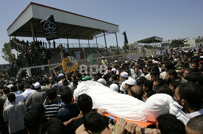 Palestinians attend the funeral of militant Kamal al-Nayrab, secretary-general of the Gaza-based group the Popular Resistance Committees (PRC) and five other people including a baby, killed in Israeli air strikes in the Rafah refugee camp, southern Gaza Strip, on August 19, 2011. Israeli fighter jets bombed Gaza, killing a teenager and injuring five people, in retaliation to a series of coordinated attacks on August 18 near the southern Israeli sea resort of Eilat that left eight dead. Photo by Abed Rahim Khatib
