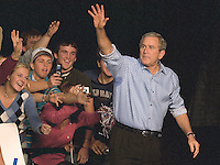 President George W. Bush waves to the crowd as he leaves MetraPark Arena following the Montana Victory Rally in Billings, Mont., Thurs., Nov. 3, 2006. Bush was campaigning for incumbent Repubilican Sen. Conrad Burns, and Rep. Denny Rehberg. Stephen Brashear/Bloomberg News