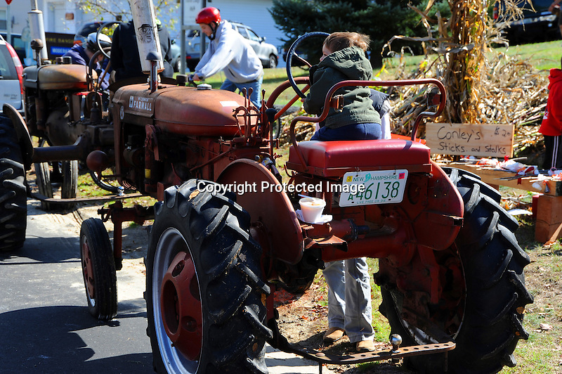 Young Boy on Antique Tractor at the Annual Harvest Festival in the Village of Marlow, New Hampshire USA