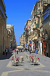 Busy city centre pedestrianised street in  Valletta, Malta
