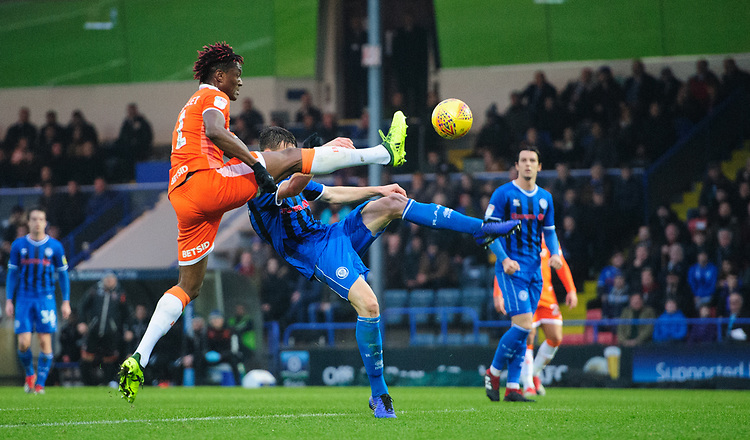 Blackpool's Armand Gnanduillet vies for possession with Rochdale's Ryan Delaney<br /> <br /> Photographer Chris Vaughan/CameraSport<br /> <br /> The EFL Sky Bet League One - Rochdale v Blackpool - Wednesday 26th December 2018 - Spotland Stadium - Rochdale<br /> <br /> World Copyright © 2018 CameraSport. All rights reserved. 43 Linden Ave. Countesthorpe. Leicester. England. LE8 5PG - Tel: +44 (0) 116 277 4147 - admin@camerasport.com - www.camerasport.com