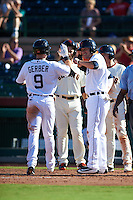 Scottsdale Scorpions outfielder Mike Gerber (9) high fives JaCoby Jones (4) after hitting a home run during an Arizona Fall League game against the Surprise Saguaros on October 22, 2015 at Scottsdale Stadium in Scottsdale, Arizona.  Surprise defeated Scottsdale 7-6.  (Mike Janes/Four Seam Images)