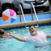 NWA Democrat-Gazette/FLIP PUTTHOFF <br /> POOL PARTY<br /> Nick Spainhower bats a ball on Wednesday Aug. 8 2019 during a water aerobics class at the Gravette city pool. The Billy V. Hall Senior Activity and Wellness Center in Gravette has offered water aerobics through the summer. The final session will be Friday. Once Gravette schools start on Aug. 14, the pool will be open Saturdays and Sundays only through Labor Day weekend.