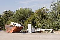 Skip container full at a retail park UK..©shoutpictures.com..john@shoutpictures.com