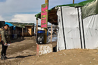 """Welcome.<br /> <br /> Calais Jungle Camp.<br /> <br /> Under the Sky of Calais & Dunkirk. Two Camps, Two Sides of the Same Coin: Not 'migrants', Not 'refugees', just Humans.<br /> <br /> France, 24-30/03/2016. Documenting (and following) Zekra and her experience in the two French camps at the gate of the United Kingdom: Calais' """"Jungle"""" and Dunkirk's """"Grande-Synthe"""". Zekra lives in London but she is originally from Basra in Iraq. Zekra and her family had to flee Kuwait - where they moved for working reason - due to the """"Gulf War"""", and to the Western Countries' will to """"export Democracy in Iraq"""". Zekra is a self-motivated volunteer and founder of """"Happy Ravers"""", a group of people (not a NGO or a charity) linked to each other because of their love for rave parties but also men and women who meet up every week to help homeless people and other people in need in Central London. (Here there are some of the stories I covered about Zekra and """"Happy Ravers"""": http://bit.ly/1XVj1Cg & http://bit.ly/24kcGQz & http://bit.ly/1TY0dPO). Zekra worked as an English teacher in the adult school at Dunkirk's """"Grande-Synthe"""" camp and as a cultural mediator and Arabic translator for two medic teams in Calais' """"Jungle"""". Please read her story at the beginning of this reportage."""