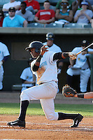 Charleston RiverDogs infielder Abiatal Avelino #18 at bat during a game against the Augusta GreenJackets at Joseph P. Riley Jr. Ballpark on April 13, 2014 in Charleston, South Carolina. Augusta defeated Charleston 2-1. (Robert Gurganus/Four Seam Images)