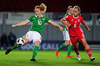 Rachel Furness of Northern Ireland vies for possession with Elise Hughes of Wales during the UEFA Womens Euro Qualifier match between Wales and Northern Ireland at Rodney Parade in Newport, Wales, UK. Tuesday 03, September 2019