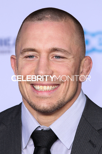 "HOLLYWOOD, LOS ANGELES, CA, USA - MARCH 13: Georges St-Pierre at the World Premiere Of Marvel's ""Captain America: The Winter Soldier"" held at the El Capitan Theatre on March 13, 2014 in Hollywood, Los Angeles, California, United States. (Photo by Xavier Collin/Celebrity Monitor)"