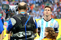 A TV cameraman focuses his lens on Lionel Messi of Argentina before kick off