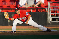 First baseman Michael Ortiz #21 of the Hickory Crawdads stretches for a throw against the Greenville Drive at  L.P. Frans Stadium May 8, 2010, in Hickory, North Carolina.  Photo by Brian Westerholt / Four Seam Images