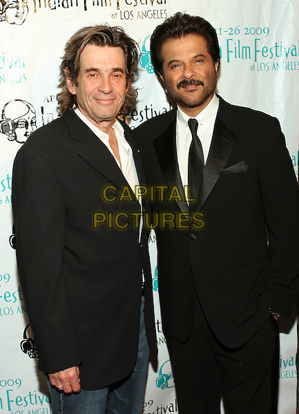 ALAN ROSENBERG & ANIL KAPOOR.The Indian Film Festival of Los Angeles held at the Arclight, Hollywood, CA, USA..April 24th, 2009.half length black suit jacket moustache mustache facial hair stubble.CAP/ADM/TC.©T. Conrad/AdMedia/Capital Pictures.