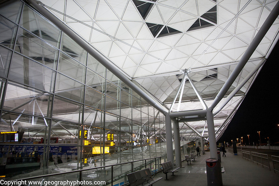 Architectural detail illuminated by lights at night, Stansted airport, Essex, England