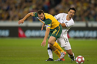 MELBOURNE, AUSTRALIA - MAY 24, 2010: Lucas Neill of the Qantas Socceroos holds off Rory Fallon of New Zealand at the FIFA World Cup farewell match between Australia and New Zealand at the Melbourne Cricket Ground, 24 May, 2010 in Melbourne, Australia. Photo by Sydney Low / www.syd-low.com