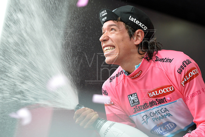 ITALIA. 22-05-2014. El nueva malla rosa Rigoberto Uran -Col- (Omega Pharma Quick-Step) celebra su victoria en la etapa 12 a cronómetro individual entre  Barbaresco y Barolo con una distancia de 42,2 Km en la versión 97 del Giro de Italia hoy 22 de mayo de 2014. / The new pink jersy Rigoberto Uran -Col- (Omega Pharma Quick-Step) celebrates his victory on the 12th stage, single stopwatch, between Barbaresco and Barolo with a distance of 42.2 km in the 97th version of Giro d'Italia today May 22th 2014.   Photo: VizzorImage/ Gian Mattia D'Alberto / LaPresse<br /> VizzorImage PROVIDES THE ACCESS TO THIS PHOTOGRAPH ONLY AS A PRESS AND EDITORIAL SERVICE AND NOT IS THE OWNER OF COPYRIGHT; ANOTHER USE HAVE ADDITIONAL PERMITS AND IS  REPONSABILITY OF THE END USER