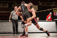 STANFORD, CA - January 18, 2015: Maxwell Hvolbek of the Stanford Cardinal wrestling team competes during a meet against Air Force Falcons at Maples Pavilion. Stanford won 27-8.