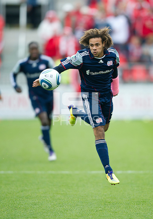22 October 2011: New England Revolution defender Kevin Alston #30 in action during a game between the New England Revolution and Toronto FC at BMO Field in Toronto..The game ended in a 2-2 draw.