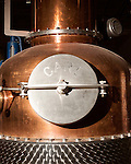 June 18, 2013. Chapel Hill, North Carolina<br />  The entire TOPO Distillery system, including this kettle still, is made by CARL Distilleries and is estimate to have cost over 1 million dollars.<br />  TOPO, Top of the Hill Distillery, the brainchild of owner Scott Maitland and Spirit Guide Esteban McMahan, is located in the old N&O Building on Franklin Street. Making gin, vodka and American whiskey from locally sourced wheat, they are one of the few distilleries bringing  organic liquor to ABC shelves around the state.